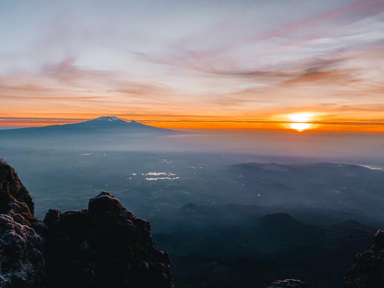 Sunrise over Mount Kilimanjaro as viewed from Mount Meru Tanzania
